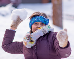 A girl winds up to throw a snowball (NimonPro.com) Tags: bigfresnofair countyfair fair competition competitionentry nikon d610 snow snowball throwing lookingatcamera smiling smile girl woman cold jacket gloves snowballfight