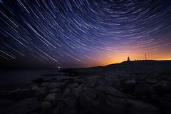 Bua Lighthouse Trails (Arvid Bjrkqvist) Tags: sweden lighthouse light stars trails bua varberg night yellow glow rocks sea coast water peoples photographers sky puple blue
