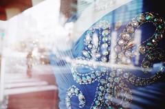 Jeweled behind glass (Eric Flexyourhead) Tags: chuo chuoku  osaka  kansai  japan  city urban detail fragment shop store window glass reflections mannequin dress blue jewels shallowdepthoffield bokeh ricohgr