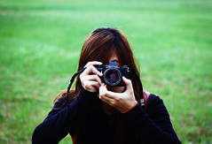 Pentax and her (Minh Hoang/Chi Bo) Tags: black green film me grass yellow 35mm hair perfect peace pentax happiness tshirt tiny bracelet f2 supper 135 50 ricoh perfection
