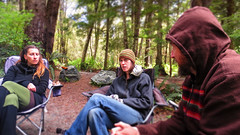 Listening (Aaron Licht) Tags: camping friends hat forest spring eyes sitting bc vancouverisland listening conversation talking frenchbeach