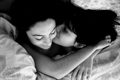 matin (asketoner) Tags: bed girls kissing sheets bedroom paris arms embracing hair dark faces portrait couple lying morning waking up