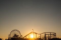 Setting Sun, Santa Monica Pier (Geraint Rowland Photography) Tags: lastlight settingsun sunset sunsetsincalifornia visitcalifornia silhouette light shadow funfair rollercoaster santamonica california unitesstatesofamerica geraintrowlandphotography travelphotographyinusa sky beach canon