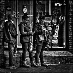 He Was Watching The Ladies While Their Attention Was Directed Elsewhere, Martin Luther King, Jr. Avenue, Historic Anacostia, Washington, DC (Gerald L. Campbell) Tags: streetphotography street squareformat spirituality spiritualindifference socialdocumentary alienation aloneness anacostia bw blackwhite citylife community dc washingtondc digital historicanacostia indifference urban urbanphotography 2xextender canong7x