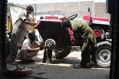 Mechanic Shop (muhammadabdullah_k) Tags: charsada pakistan interest free loans microfinance entrepreneurship pakhtoon ordinary people small business akhuwat mechanic tractor cars