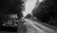 Dull, rainy day (danielfj91) Tags: bw car land rover iceland black white portrait gravel road offroad nature machine