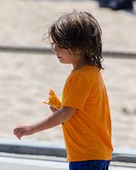 Orange (Kevin MG) Tags: usa ca losangeles manhattanbeach beach sand water ocean fun kids children young youth little adolescent eating