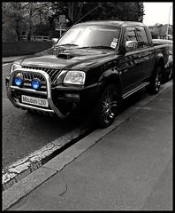 Urban Beast (larry_shone) Tags: car suv 4x4 mitsubishi blackandwhite urban selectivecolour