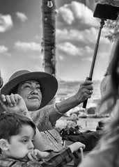 DSC_3451 Selfish Woman (P Shooter) Tags: people nikon nikond7100 blackandwhite candid candidcapture candidcamera selfie selfy selfiestick prettywoman outdoors monochrome