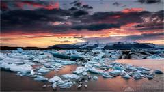 Sunset Over Jokulsarlon (Darkelf Photography) Tags: jokulsarlon glacier lagoon iceland europe landscape iceberg sunset evening dusk clouds mountains reflections seascape filter canon 1635mm 5diii maciek gornisiewicz darkelf photography sunsetoverjokulsarlon 2015 lee