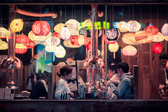 Seoul Nighthawks (Jon Siegel) Tags: nikon nikkor d810 85mm 14 nikon85mmf14 man woman boy girl dining evening night restaurant lanterns beauty beautiful interior glowing ambience life people seoul korea korean southkorea hongdae street candid wongkarwai