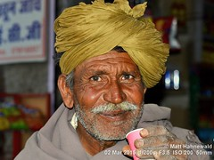 2015-03a Colourful Rajasthan (14) (Matt Hahnewald) Tags: rajasthaniturban pagari drinking milktea chai moustache yellowturban lefthand matthahnewaldphotography facingtheworld photography photo image outstanding fantastic favourite superior excellent nikond3100 nikkorafs50mmf18g primelens 43aspectratio horizontalformat portrait portraiture headshot enface colour colourful worldcultures cultural character personality realpeople human humanhead humanface humaneyes facialexpression eyecontact rajasthanipagari turban consent empathy rapport encounter emotion environmentalportrait ethnicportrait travel travelportrait traveldestination tradition jaisalmer rajasthan india oneperson male adult indianman posing authentic incredible awesome livedinface wrinkles rajasthaniman manly 50mm outside yellow closeup street