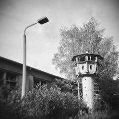 Surveillance (Ralph Graef) Tags: holga monochrome factory tower surveillance gdr watchtower blur lomography supervision lantern control