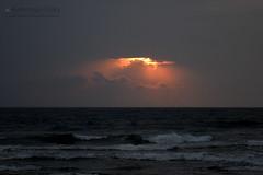 Hiding sun (Venkataramesh.Kommoju) Tags: sun clouds hiding sunset tides sea dark dusk rays lightning