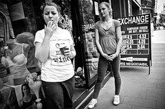 Lingerie and Cigarettes (stimpsonjake) Tags: nikoncoolpixa 185mm streetphotography bucharest romania city candid blackandwhite bw monochrome women cigarettes store lingerie smoking bras