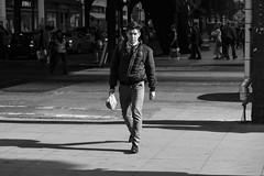 Mr Serious (Torsten Reimer) Tags: shadow usa people schatten candid northamerica walking chicago mann illinois man schwarzweis blackandwhite pavement unitedstatesofamerica schwarzwei unitedstates us