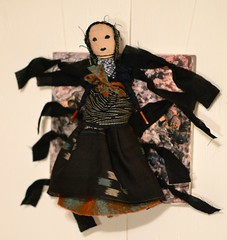 the wise lady, panel#10. (Danny W. Mansmith) Tags: burienarts vision2020 fundraiser 10of10 dannymansmith handmade doll figure lady dress painting housepaint metaleyelets fabric handsewing face treebranches burienwashington oneofakind buriencommunitycenter november 2016 magic witch