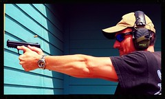 Shooting M&P9 (Eric Holmes) Tags: black utah nikon gun howard smith pistol deux guns shooting mp grip brass oakley nra mille d90 wesson leight mp9 kadloo mp9fs bustem