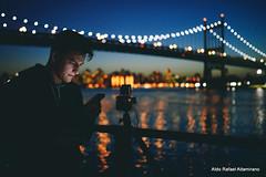 Counting down (Rafakoy) Tags: camera city nyc portrait people urban ny newyork color film water colors skyline digital reflections cityscape dusk queens eastriver astoria epson astoriapark triborobridge triboroughbridge 2013 hasselblad500 nikond800 robertfkennedyrfkbridge sigma35mmf14dghsm