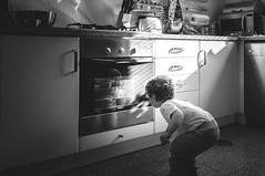 Just Curious ([Schmitzoide]) Tags: blackandwhite kitchen kid oven staring