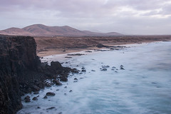 Long Waves in El Cotillo (smokejumping) Tags: longexposure winter light sea beach twilight spain nikon rocks surf mare waves desert wind fuerteventura playa surfing cliffs espana biospherereserve february rocce inverno atlanticocean canaryislands spiaggia luce spagna vento deserto onde scogliere islascanarias crepuscolo febbraio toston elcotillo oceanoatlantico lungaesposizione 2013 d80 isolecanarie riservadellabiosfera sergiocanobbio