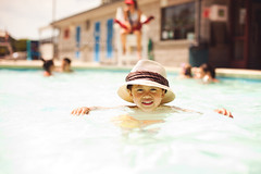Staying cool during this hot weather (JMSF415) Tags: family boy summer water pool hat swimming dof roman bokeh son nikkor50mm14 nikond3 jmsf415 jorgemorenophotography jorgemorenojrphotography