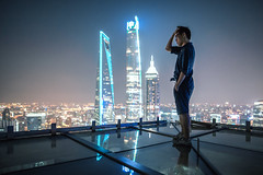 Portrait of young man standing on the rooftop (HIKARU Pan) Tags: portrait rooftop outdoors man shanghai china asia shanghaiworldfinancialcenterswfc jinmaotower shanghaitower lujiazui reflection chinese light night evening 24l canonef24mmf14liiusm 1dx eos1dx city landmark photography horizontal wideangle