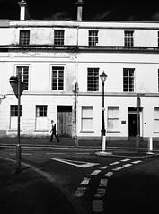 Stride On (Feldore) Tags: man walking street stride striding markings belfast northern ireland irish candid signs white feldore mchugh em1 olympus 17mm 18 terrace houses