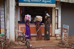 Why holding a bag when you can carry it on your head? (Scalino) Tags: india karnataka travel trip badami durga temple fromtherickshaw streetphotography street surprise unposed onspot passingby women head carrying bag