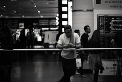Slightly Entertained (.:Axle:.) Tags: toronto ontario canada street random urban city downtown streetphotography people strangers informal nikonf5 nikon slr 35mm 135 afdcnikkor105mm12d japancamerahunter streetpan jchstreetpan400 asa400 kodakxtol 11 epsonv700 adobephotoshopcc bw blackwhite monochrome film filmphotography believeinfilm filmisalive filmisnotdead