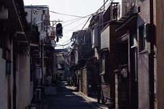 (  / Yorozuna) Tags:    alley alleyway       kyoto  kyotocity    kujo  higashikujo  house     morning pentaxautotakumar55mmf18  electriccable electricline electricwire