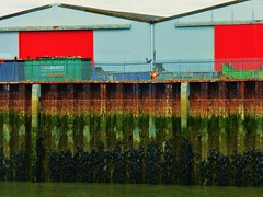Warehouses (teaselbrush) Tags: newhaven east sussex uk england british seaside town coast coastal urban ouse river murky dank seaweed barnacles green slime slimy mud tidal decay industrial warehouses rust rusty rusted bright colours red