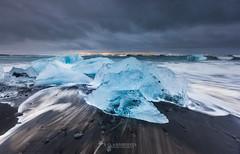 Ice beach at jokulsarlon, Iceland. (Kanonsky) Tags: arctic beach beautiful black blue cloudy cold europe glacier ice iceberg iceland jokulsarlon lagoon nature north ocean sand sea sunrise volcanic wave winter