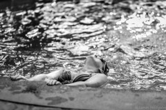 The Swimmer (James Hodgson Photography) Tags: swimmer bikini woman swimming italy sorrento travel black white monochrome candid prime 85mm canon breasts sunglasses pool moment sparkle reflection swimsuit