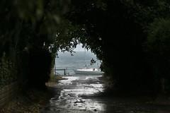 in fondo al tunnel (robertoriservato) Tags: estate pioggia barca vela verde rain boat summer