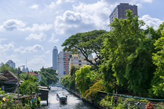 Water taxi (bdrc) Tags: asdgraphy landscape scenery river canal boat ship taxi cloud sky plant bangkok thailand holiday travel day sony a6000 sigma 30mm prime urban city tower