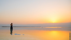Yellow Sunrise at the Dead Sea (barak.shacked) Tags: inthewater sunlight saltsea water womanreflection yellowsunset waterreflection outdoor female clean clear blackdress womansback beutifull sun sea sunrise view woman landscape colors womaninthesea deadsea reflection mountain