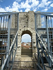 Arles Amphitheatre (AmyEAnderson) Tags: outdoor coliseum amphitheatre stadium architecture historic roman romanesque sporting france provence arles bouchesdurhone railing angles steps stairs arch archway limestone bleachers rooftops stonework clouds unesco