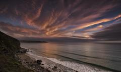Tongues of Fire (explored) (yadrad) Tags: sunset cornwall sky clouds whitsands whitsandbay southwest coast beach tide fujixe1 thesouthwest