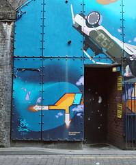(e_alnak) Tags: uk greatbritain blue urban streetart color art creativity graffiti colorful colore graphic unitedkingdom britain vivid urbanart doorway streetartist spraypaint graffito archway blau farbe couleur bold graffeur graffitis distinct kleur crashtestdummies ealnak