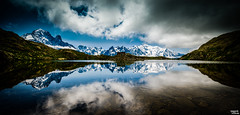 Many miles above, sits a single house - D800 - Explored (Teo Morabito) Tags: lake mountains reflection landscapes lac chamonix blanc