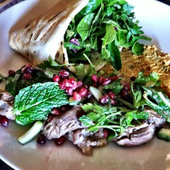 Slow cooked lamb shoulder with hommus and salad at Fitzrovia in St Kilda (ultrakml) Tags: cameraphone food lunch cucumber mint pomegranate australia melbourne victoria lamb parsley shoulder stkilda iphone hommus iphone4 iphoneography cameraplus