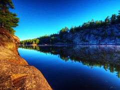mirror (paul bica) Tags: morning trees sky ontario nature water sunrise river french paul outdoors mirror early rocks quiet calm shore serene dex bica dexxus 20120806thunderbay1014d