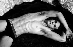 Hot Man lying on black sand (Jaclyn Diva) Tags: handsomemen hunkalicious hunkymen attractivemen jaclyndiva underwearmalemodels