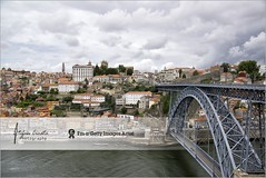 Dom Luis Bridge | Porto, Portugal (Stefan Cioata) Tags: old travel bridge houses vacation sky holiday detail portugal water beautiful clouds river boats photography photo site scenery arch view image sale steel postcard exploring details hill great stock pedestrian scene best explore porto walkway shore douro getty destination top10 available between outstanding vilanovadegaia metrodoporto touristical flickrandroidapp:filter=none