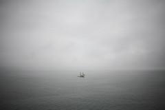 Alone (EYE///STONE) Tags: ocean sea boat alone ship gray maine overcast sail lone