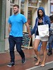 Brian McFadden and fiancee Vogue Williams out doing some last minute shopping around Grafton Street. Brian gives his hoodie to Vogue during a rain shower. Dublin, Ireland