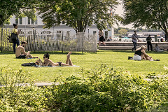 End Of Summertime Where Young People Are Getting In One Last Sun Tan At The Park (nrhodesphotos(the_eye_of_the_moment)) Tags: dsc05465160 theeyeofthemoment21gmailcom wwwflickrcomphotostheeyeofthemoment summertime season candid urban batterypark grass plantlife people girls men piera hudsonriver tanning relaxing fence trees manhattan nyc boats perspective outdoor greenery recreation windows metal building architecture yard bathingbeauty robertwagnerpark nycpark waterfront nyharbor lightfixtures streetlights