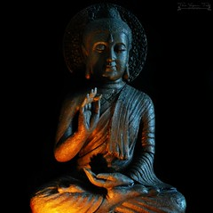 Buddha (The Vegan Taff Photography) Tags: buddha statue stone carved religion religious buddhist buddhism candlelight candlelit blackbackground dark darkphotography candleilluminated nikond3200 nikon d3200 indoors inside texture stonework
