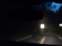 Scenes from the back seat (johnemount) Tags: rearview backseat car driving countryroad window windshield night twilight moody melancholy